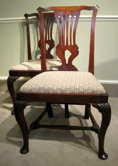 A fine pair of George 1st period solid walnut side chairs, with interlaced backs, raised on leaf carved cabriole legs united by turned H stretchers. Circa 1720. RD.