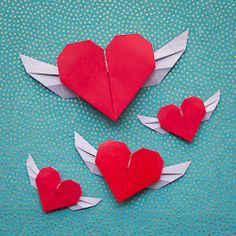 Cute origami hearts with wings from a single sheet. No glue or scissors required! #craftgawker