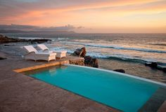 Travel Inspiration for South Africa - White wicker loungers, ostrich-feather lampshades and fresh roses contribute to creating the most tasteful of holiday terrains, especially when teamed with a plunge pool running down the centre of Birkenhead House and an infinity version out front, looking towards the sea