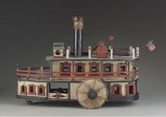 CARVED AND PAINTED PULL-TOY MODEL OF A STEAMSHIP AMERICAN, CIRCA 1890