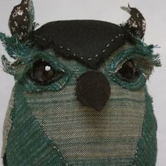 "275.00 Teal Perching Owl: 6 1/2"" made from  antique jacket - fabric is beautifully faded and variegated teal flannel,antique glass button eyes and is stuffed with organic wool."