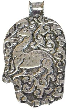 """Sterling Hand - Nepal - sterling silver hand pendent is equally beautiful on both sides. Front has a nice piece of turquoise with a repousse' om figure carved into it and the back has traditional Nepalese repousse' carving with a graceful deer in the center.  3 3/8T x 2""""W x 5/8""""D"""