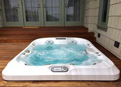 jacuzzi brand spa set in deck
