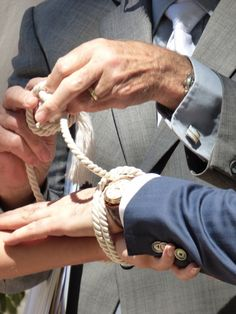 Tying the knot to seal their marriage vows. Photograph by Cherry Thatcher