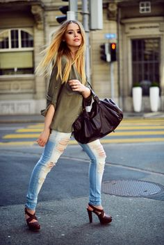 justthedesign:  Kristina Bazan in olive shirt and ripped jeans