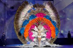 The spectacular costumes – covered in feathers, sequins and jewels – can be more than five metres high and weigh up to 80kg.
