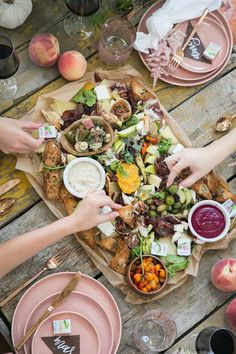 A fall charcuterie party is a great way to host friends a family! We kept it casual with a large platter and pillows on the floor!