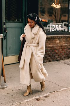 WRAP UP: Stay warm in style with faux fur coat – team with neutral accessories for an effortlessly chic take on tonal dressing, as… New York Fashion Week Street Style, Fur Fashion, Stay Warm, Faux Fur, My Style, How To Wear, Clothes, Holly Brown, News Archives