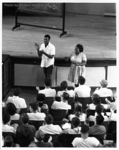 SNCC staff leads volunteers in freedom songs during the second 1964 SNCC Orientation Session at Western College for Women in Oxford, Ohio. In the front of the audience, right, is Fannie Lou Hamer and, left, SNCC staff member Chuck Neblett. Courtesy McCain Library and Archives, University of Southern Mississippi.