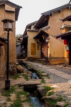 Beautiful streets of Shaxi in China. Put it on your list of places to visit in China. Photo - NOMADasaurus #backpackingchina #yunnan #ancientcitieschina