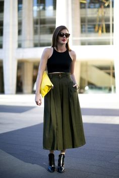 black crop top and army green skirt