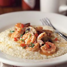 Shrimp & Grits (Williams Sonoma)- Ingredients: 1 1/2 lb. large shrimp, peeled and deveined 2 Tbs. all-purpose flour  6 oz. bacon slices, cut into 1/2-inch dice, fried    until crispy and fat reserved  1/3 lb. white button mushrooms, sliced  1/3 cup diced red bell pepper  2 garlic cloves, minced  1/3 cup sliced green onions, white and light    green portions  2 plum tomatoes, diced  1/3 cup chicken stock  4 tsp. fresh lemon juice  1 1/2 tsp. Tabasco sauce. Serves 6.