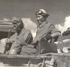 Japanese PoWs sitting in the back of a truck 1944 or 1945