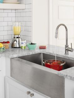 The Balanises had room for only a small dishwasher, so they made up for it with a deep, 30-inch-wide farmhouse sink from overstock.com. The stainless steel finish matches the appliances.