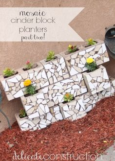 mosaic cinder block planters pt2.  I want to do this so badly!  I saw one with succulents and it was so great!