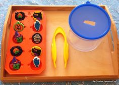 Tongs with manipulatives (puff balls, cotton balls) as TEACCH Task for fine motor