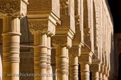 Finely detailed columns within the Chamber of the Lions at Alhambra Palace are among the most famous pieces of architecture in the city of Granada, Andalusia, Spain. Andalusia Spain, Andalucia, Famous Architecture, Architecture Design, Architectural Columns, Facade, The Incredibles, Cathedrals, Arches