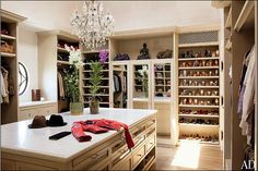 """Interesting idea for a walk-in closet. At this point, it really becomes more of a closet """"room."""" :) Just needs a comfy sofa chair and a three-way full-length mirror and then it'll be complete. :)"""
