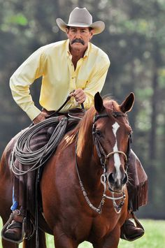 Pat Parelli.... He is amazing with horses, I got to see him today and it was so cool