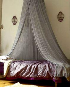 Romantic bed with bohemian fabrics