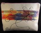 iPad/Tablet sized pouch. Free machine embroidered design