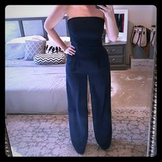 """Sam Edelman Jumpsuit This is a STUNNING and extremely flattering navy jumpsuit by Sam Edelman.  This is a size 8 and I believe it runs true to size.  This is exceptional in every way, it has a shaping bodice with """"boning"""" which makes a perfect hourglass shape as well as black mesh paneling in back allowing for some stretch.  The wide leg and pockets make this jumpsuit so cutting edge and trendy.  Pair with a blazer for work or heels for an upcoming black tie event, perfect for many…"""
