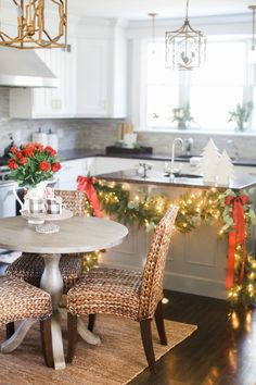 It's a holly jolly kitchen design: Design: The Kleker Family - http://www.stylemepretty.com/portfolio/the-kleker-family Photography: Ruth Eileen Photography - rutheileenphotography.com/ Read More on SMP: http://www.stylemepretty.com/living/2016/12/22/a-magical-holiday-home-tour-with-a-strong-mantel-game/