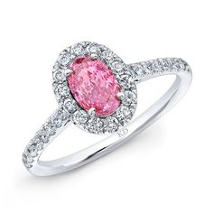 18K WHITE GOLD ELEGANT DIAMOND ENGAGEMENT RING FEATURING PINK COLOR ENHANCED OVAL CENTER DIAMOND TOTALING 0.58 CARAT AND COMPLEMENTED BY HALO WHITE DIAMONDS