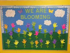 Summer Bulletin Boards For Daycare Discover Spring bulletin board with puffy paint handprints and clouds School Welcome Bulletin Boards, Toddler Bulletin Boards, Flower Bulletin Boards, Kindergarten Bulletin Boards, Summer Bulletin Boards, Christmas Bulletin Boards, Birthday Bulletin Boards, Teacher Bulletin Boards, Preschool Bulletin Boards
