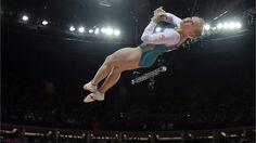 Canadian gymnast Elsabeth Black photographed mid-vault