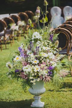 Fabulous urn full of Summer blooms to line the aisle | onefabday.com