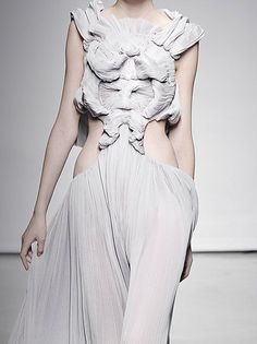 Designer: Yiqing Yin. She has used pleats, fabric treatment, fabric…