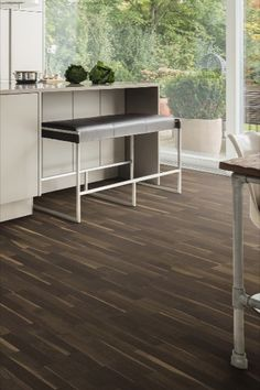 #Brown comes in many different shades. The #parquetfloors from this colour world are available in different light and dark tones. The dark Plank 1-Strip 2V Ash Fancy impresses, for example, with an intensive black/white contrast, while the Longstrip in American Walnut shines in a warm shade of brown.  #brownshades #darktones #brownparquet #classic #elegant #brownoak #rustic #contemporary #country Engineered Timber Flooring, Parquet Flooring, Moodboard Inspiration, Brown Shades, American Walnut, Rustic Contemporary, Plank, Light In The Dark, Dining Bench
