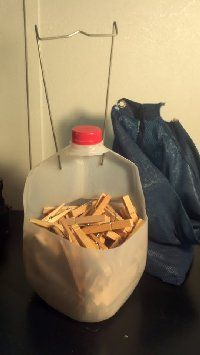 Clothespin Caddy - repurposed milk jug and the hanger from my worn out clothespin bag (could use a wire coat hanger, too)