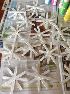 Snowflakes made out of Popsicle sticks, white paint, and glitter! Good to hand in your house or outside!