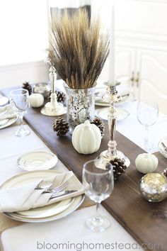 12 Easy and Gorgeous DIY Thanksgiving Centerpieces Metallic candle holders, frosted pinecones, and white pumpkins stand out against a dark stained wood table runner. Diy Thanksgiving Centerpieces, Thanksgiving Tablescapes, Holiday Tables, Thanksgiving 2020, Outdoor Wedding Decorations, Table Decorations, Centerpiece Ideas, Table Centerpieces, Rustic Table Runners