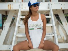 """Cuggi Tank Top. The parody copy of the Italian brand. Not made in Italy, but surely as fashionable, even when it's imitated.  """"I stay Cuggi down to my socks, rings and watch filled with rocks"""" according to a biggy. Check out this tank top and other tees."""