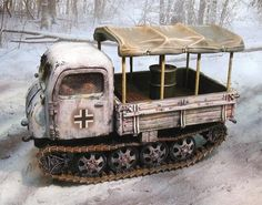 World War II German Winter CS00554 Raupenschlepper Utility Vehicle set - Made by The Collectors Showcase Military Miniatures and Models. Factory made, hand assembled, painted and boxed in a padded decorative box. Excellent gift for the enthusiast.