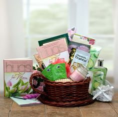 """Mom Deserves A Hug and Some Relaxation Gift Basket - $79.99 Gift Basket Includes  Gift basket, """"Hugs for Mom"""" book, 2 Green tea packets, Chocolate tiramisu coffee, Chocolate biscotti, Fudge brownie, Pedicure set, Drawer sachet, Magnetic notepad, Votive candle, Bath confetti, Loofah, Cucumber Melon body lotion, Cucumber Melon bath gel  Ships From MO 14.95 http://www.finegifts.labellabaskets.com/"""