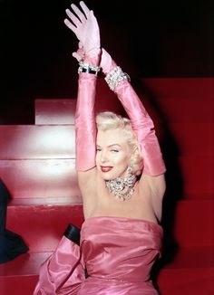 "Marilyn Monroe in a pink dress and gloves, performing ""Diamonds are a Girl's Best Friend"" in GENTLEMEN PREFER BLONDES."