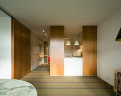 At London's Barbican Estate, midcentury apartment gets sleek revamp - Curbedclockmenumore-arrow : Local firm Azman Architects handled the refresh
