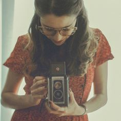hairstyle, specs and pretty vintage dress.