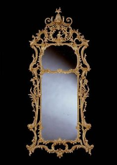 A GEORGE III CARVED GILTWOOD MIRROR - 1765