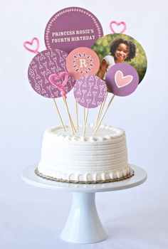 Make a personalized cake topper with paper, skewers, and photos (and more if you want)