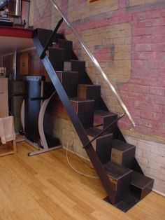 Steep space saving stairs, alternating treads.. Looks dangerous.  Lapeyre loft access