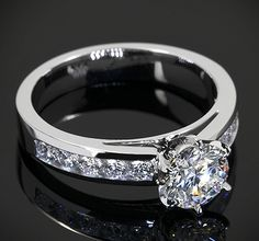 Exactly like this but with a 1 carat center stone. Please and thank you dear husband.