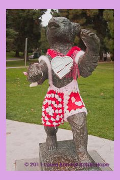 The Statute of the Griffith Park Bear dressed for Valentine's Day. Yarn bombing, yarn storming, yarn storm