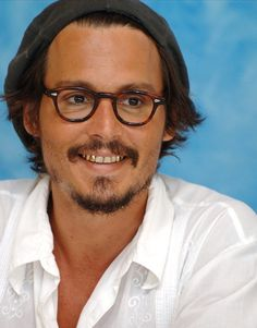 """Johnny Depp during """"Charlie & the Chocolate Factory"""" Press Conference with Johnny Depp, Tim Burton, Freddie Highmore and Richard Zanuck at the The Atlantis Resort in Bahamas, . Gold Tooth Cap, Johnny Depp Characters, Jacob Marley, Young Johnny Depp, Mr D, Freddie Highmore, Gold Teeth, New Poster, Big Hugs"""