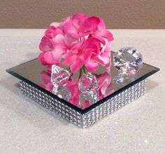 Bling Base with Mirror for Votive Candles or Vases. Adornments shown in photo are not included. Base has 5 rows of silver bling and is 1 tall and 4.25 square Mirror is 5 square. Custom and quantity orders are considered. Please message me with your requests. Thanks for liking my
