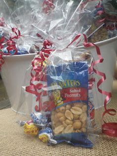 Baseball theme party favors...cute idea to give with baseball tickets to drs